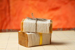 Natural soaps on a bamboo mat. Natural soap tied with a ribbon on a bamboo mat Stock Photo
