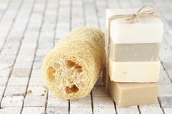 Natural soaps and loofah Stock Photos