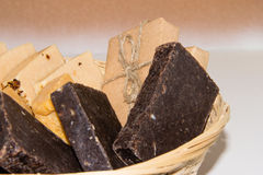 Natural soaps in wooden basket. On the table Royalty Free Stock Photo
