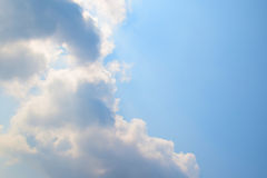 Natural soft clouds pattern and sunshine ray on blue sky background Royalty Free Stock Images