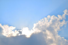 Natural soft clouds pattern and sunshine ray on blue sky background Royalty Free Stock Photography