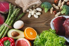 Natural sources of folic acid. As liver, asparagus, broccoli, eggs, salad, avocado, paprika, nuts, orange , beetroots and beans royalty free stock photography