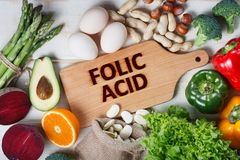Natural sources of folic acid. As asparagus, broccoli, eggs, salad, avocado, paprika, nuts, orange, beetroots and beans Stock Photography