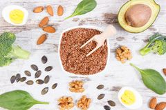 Natural sources of omega 3 acids, unsaturated fats and dietary fiber, healthy nutrition concept. Natural sources of omega 3 acids, unsaturated fats and dietary Royalty Free Stock Image