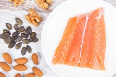 Natural sources of omega 3 acids, unsaturated fats and dietary fiber, healthy nutrition concept. Natural sources of omega 3 acids, unsaturated fats and dietary Royalty Free Stock Photos