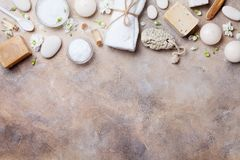 Natural spa, beauty and aromatherapy background on stone table top view. Flat lay. Stock Image