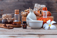 Natural Spa Ingredients herbal compress ball and herbal  Ingredi. Ents  for alternative medicine and relaxation thai Spa theme on old wooden background Stock Images