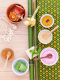 Natural Spa Ingredients . Natural Spa Ingredients sea salt , tanaka , aloe vera and honey  for alternative skin care Thai Spa theme with bamboo background Stock Image