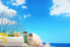 Natural spa resort. Beach items on table,Natural spa resort Royalty Free Stock Photos