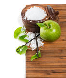 Natural spa setting with apple, salt and vanilla Royalty Free Stock Photo