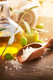 Natural spa setting with olive oil. Natural spa setting with olive and olive oil products: bath salt, natural soap and olive oil royalty free stock photos