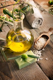 Natural spa setting with olive products. Natural spa setting with olive and olive oil products: bath salt, natural soap and olive oil royalty free stock photo