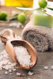 Natural spa setting with olive products. Natural spa setting with olive and olive oil products: bath salt, natural soap and olive oil stock photography