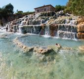 Natural spa Saturnia thermal baths, Italy. Natural spa with waterfalls  and hot springs at Saturnia thermal baths, Grosseto, Tuscany, Italy Royalty Free Stock Photography