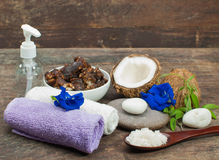 Natural spa. Spa and wellness setting with flowers, floral water and towel. Natural spa setting Stock Image