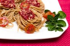 Natural  spaghetti dinner. Spaghetti dinner with little tomatos Stock Image