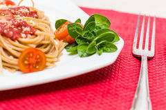 Natural  spaghetti dinner. Spaghetti dinner with little tomatos Royalty Free Stock Photography