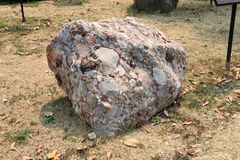 Natural specimen of conglomerate - sedimentary rock composed of rounded or sub-rounded gravel and pebbles cemented by calcium. Carbonate on ground field. High stock images