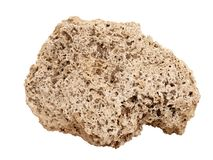 Natural sample of Travertine rock on white background. Natural specimen of Travertine limestone tufa - porous cellular sedimentary rock formed by deposition of royalty free stock photos
