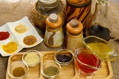 Natural spices, seasonings and sauces on a canvas background. The concept of natural food.  royalty free stock images