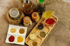 Natural spices, seasonings and sauces on a canvas background. The concept of natural food.  royalty free stock photo