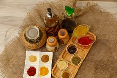 Natural spices, seasonings and sauces on a canvas background. The concept of natural food.  royalty free stock image