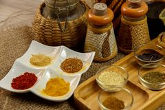 Natural spices, seasonings and sauces on a canvas background. The concept of natural food.  stock photos