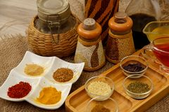 Natural spices, seasonings and sauces on a canvas background. The concept of natural food.  royalty free stock photos