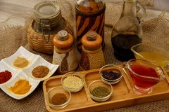 Natural spices, seasonings and sauces on a canvas background. The concept of natural food.  stock photo