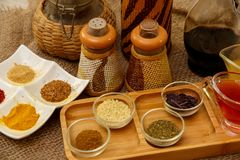 Natural spices, seasonings and sauces on a canvas background. The concept of natural food.  stock images
