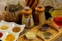 Natural spices, seasonings and sauces on a canvas background. The concept of natural food.  stock photography