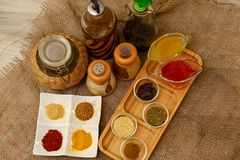 Natural spices, seasonings and sauces on a canvas background. The concept of natural food.  stock image