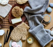 Natural sponge, loofah, towel, soap and makeup brushes, top view Stock Images