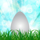 Natural spring green Background With Green Grass, Easter egg, su. N rays And bokeh lights, Vector Illustration Stock Images