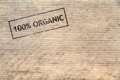 100% Natural  stamped text on old plank Stock Images