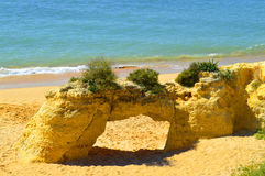 Natural stone arch on Armacao De Pera Beach Stock Photo