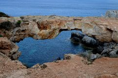 Natural stone arch/bridge at Mediterranean Sea. Natural stone arch bridge at Mediterranean Sea, Cyprus Stock Photography