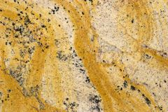 Natural Stone Backgrounds and Textures. Stone Backgrounds and Textures - Granite Slab Color - Giallo Medusa Stock Photo