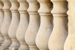 Natural Stone Balustrade. Close up detail with depth of field of balustrade with beige sandstone Columns Stock Images
