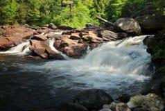 Natural Stone Bridge and Caves. Waterfall at the Natural Stone Bridge and Caves in Pottersville, NY stock photo