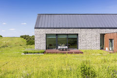 Natural stone elevation. Natural stone front house elevation surrounded by nature Stock Images