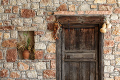 Natural stone facade and old wooden door Royalty Free Stock Photography