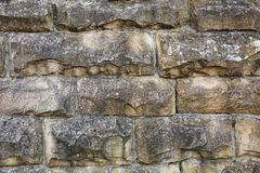 Natural stone facade, stone texture. Yellow natural stone facade, wall tiles texture royalty free stock photo