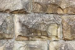 Natural stone facade, stone texture. Yellow natural stone facade, wall tiles texture stock image