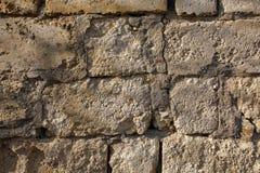 Natural stone facade, stone texture. Yellow natural stone facade, wall tiles texture royalty free stock photos