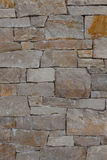 Natural stone granite brick wall pattern background, contemporar. Upscale natural stone wall pattern or background; vertical format. The wall was designed and royalty free stock photography