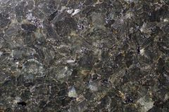 Natural stone gray granite, consisting as if of mica plates stock photos