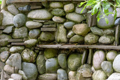 Natural stone landscaping. In home garden. Stone wall background Royalty Free Stock Photos