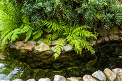 Natural stone landscaping. With water in a garden Stock Photo