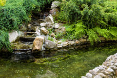 Natural stone landscaping. With water in a garden Stock Photography